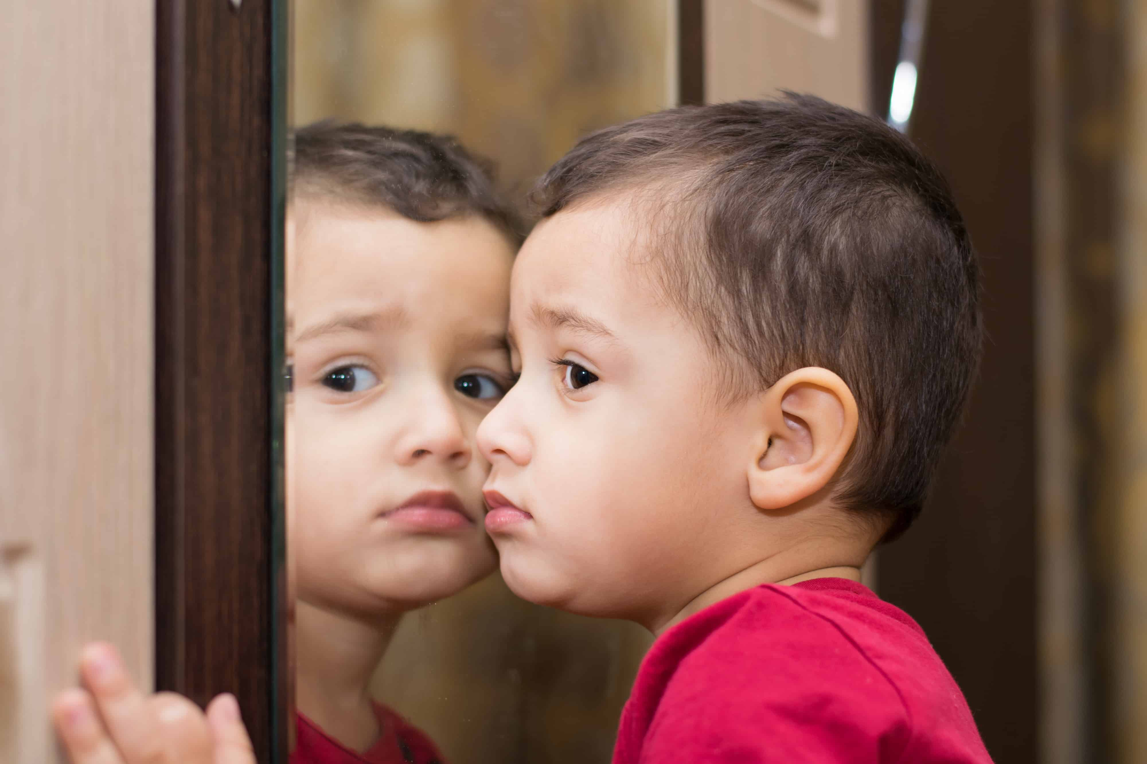 boy 2 years in front of the mirror